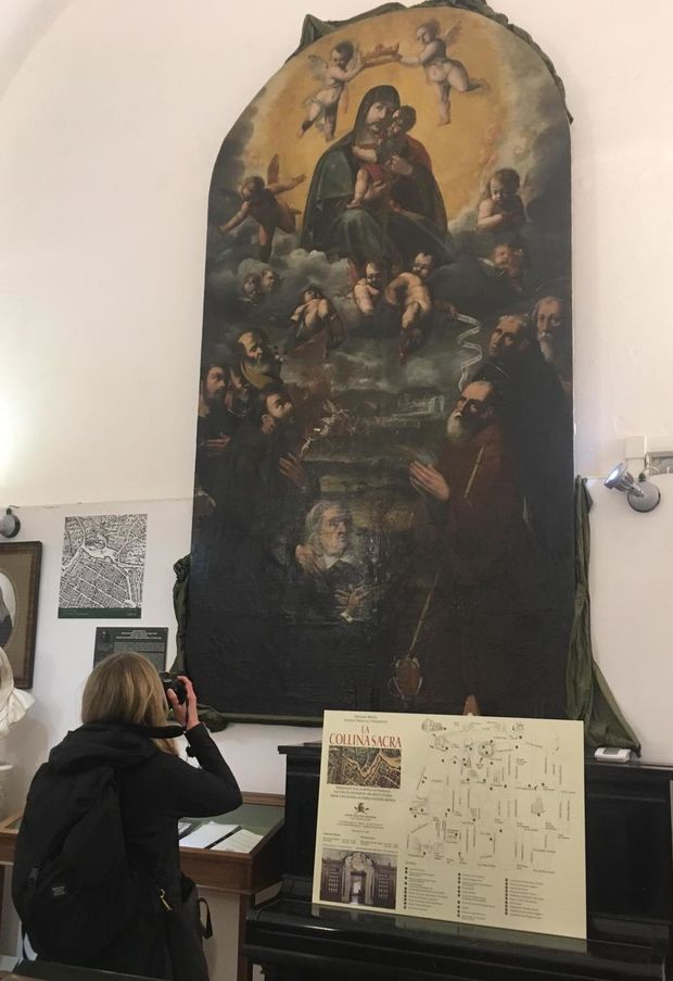 Elizabeth Duntemann photographing an altarpiece at the Ospedale Santa Maria del Popolo degli Incurabili in Naples, Italy
