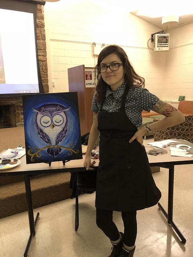 Joy Waldinger aside her sample painting at the Ambler campus