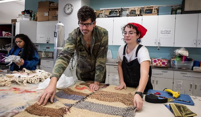 Visiting artist Machine Dazzle works with Fibers & Material Studies major Victoria Fulton at the Tyler School of Art in anticipation of the Wearable Art Show.