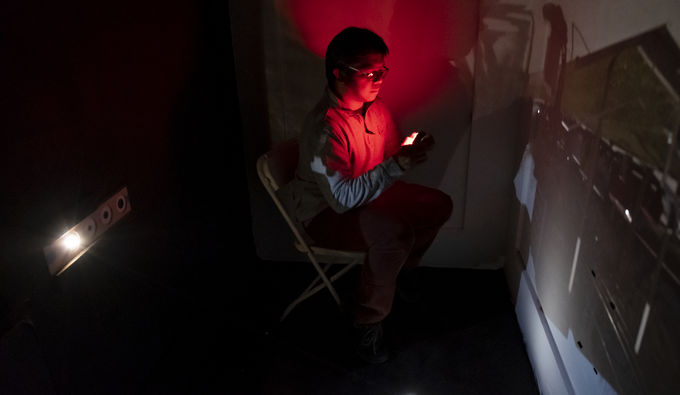 Michael Jazul, senior Photography major, projects an image within the giant camera obscura