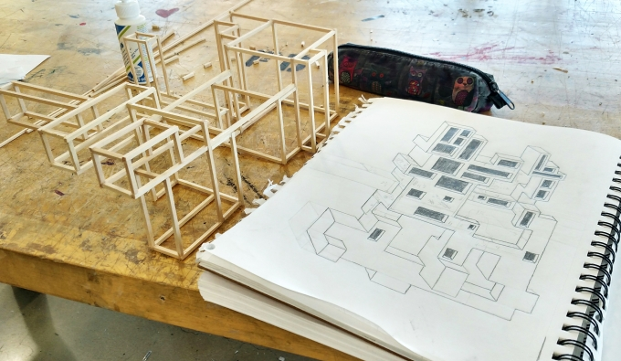 Architecture model and sketch next to each other