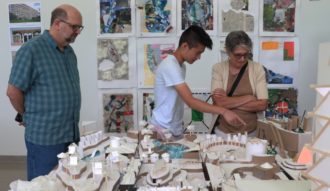 Families view students creations in the Architecture section of the student show
