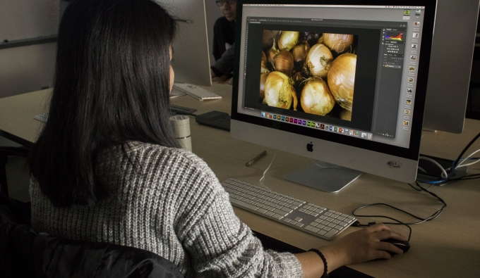 Student editing photograph on computer