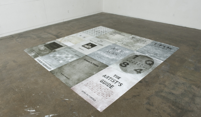 installation view of large prints on floor