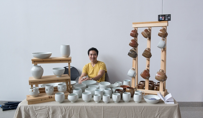 Ceramics alumnus with artwork