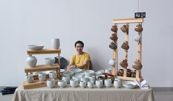 Ceramics alumnus with artwork