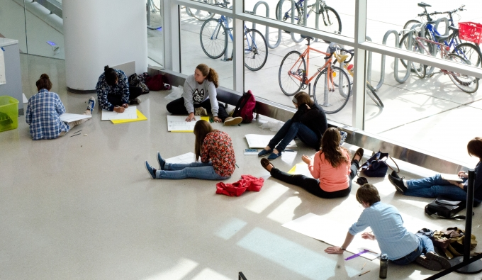 Architecture students sketching on the floor