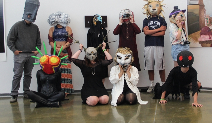 Group of pre-college students wearing masks and costumes constructed in their Sculpture workshop