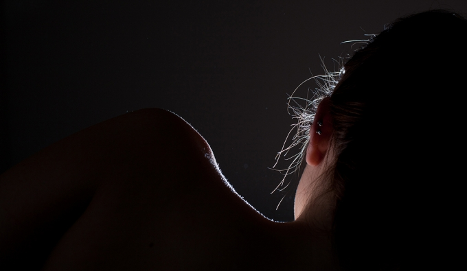 silhouette of woman's neck and shoulder