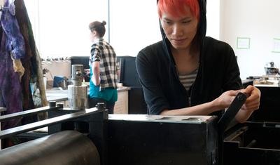 student working in the printshop