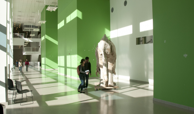 students looking at larger than life size elephant structure