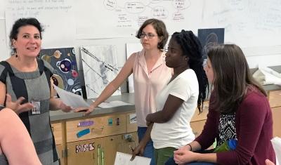 Art Education Graduate Students Communicating in Class