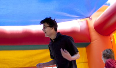 Having fun on moonbounce at the spring carnival
