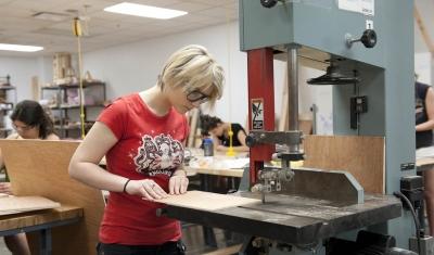 Visual Studies student in woodshop