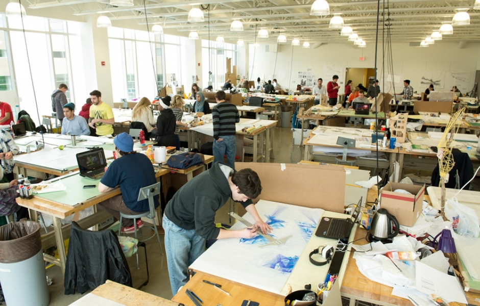 large studio filled with students working