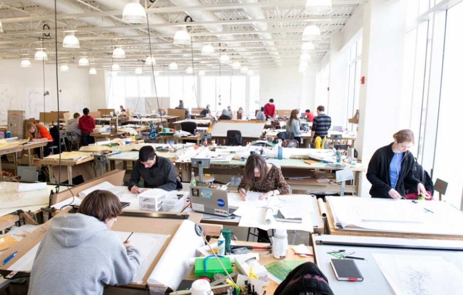 bright studio filled with working students