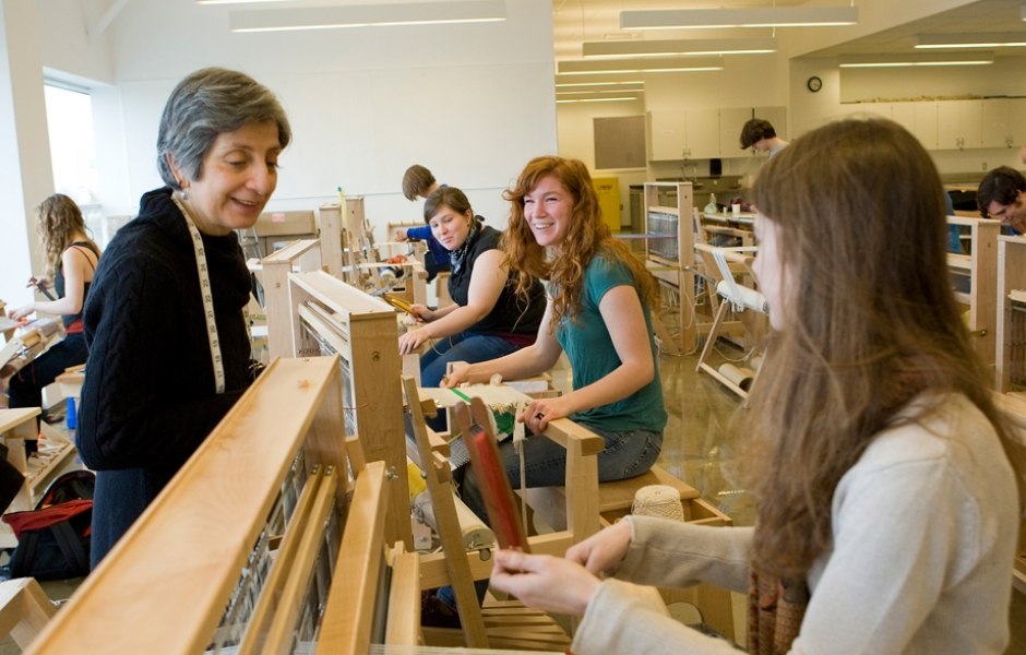 professor and students at weaving looms