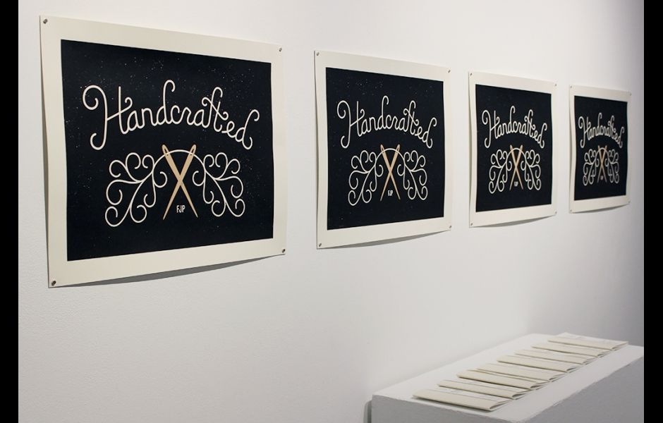 Installation of the Free Journal Project featuring silkscreen posters and handmade journals on display