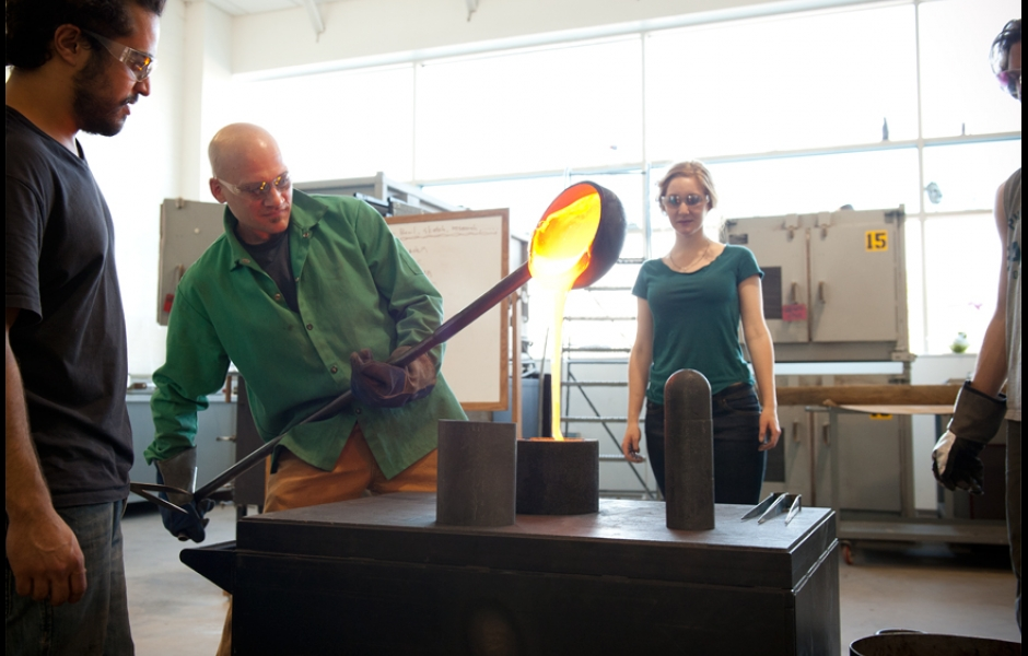professor pouring hot melted glass