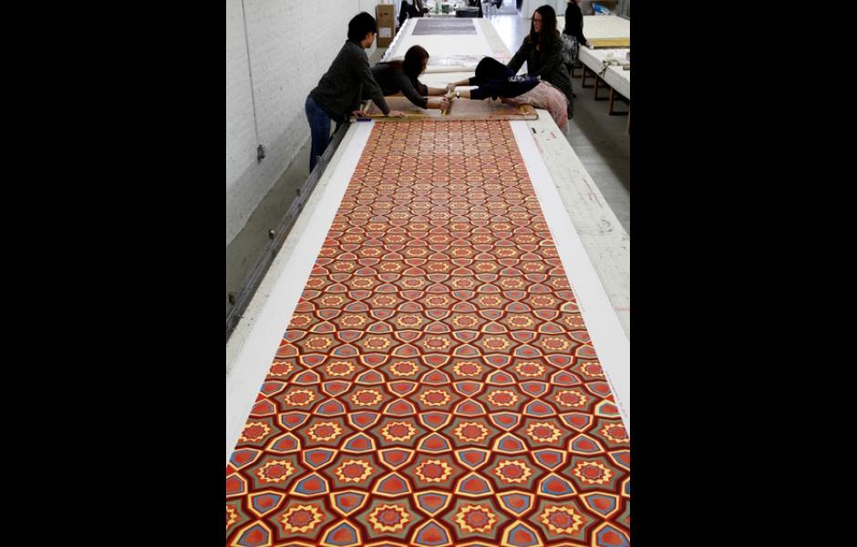 artist and helpers silkscreening