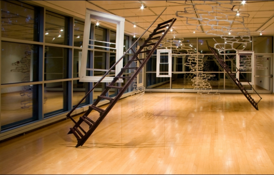 ladders and hanging paper in gallery
