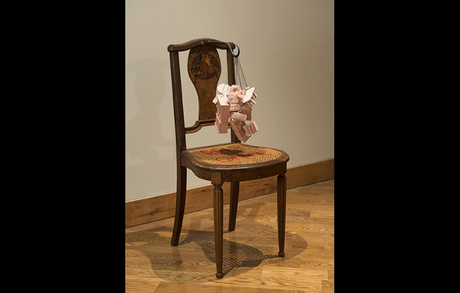 Chair with bundle of small furniture