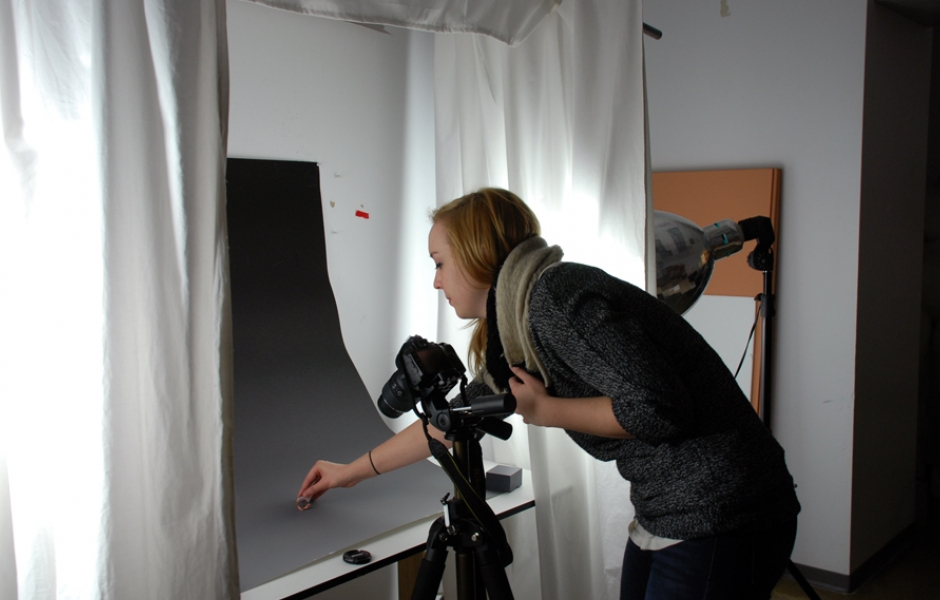 female student photographing work