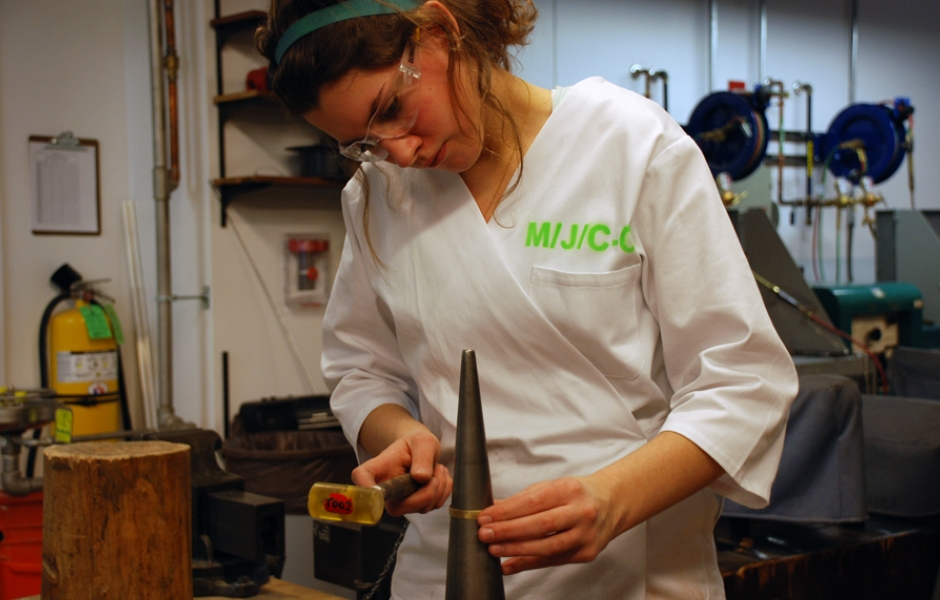 female student metal smithing