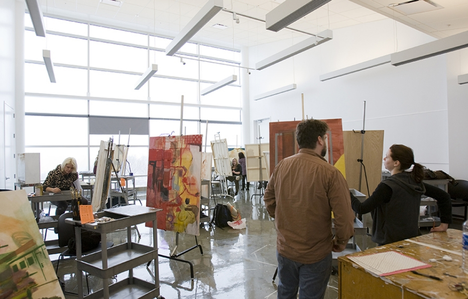 students mingle in painting studio