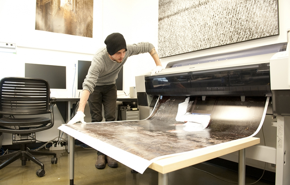 student prints large format print in photo