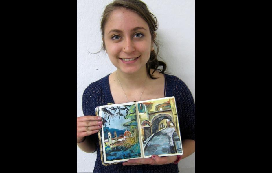 Student holding sketchbook