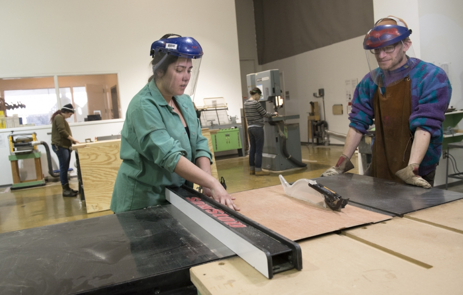 student works on sculpture project