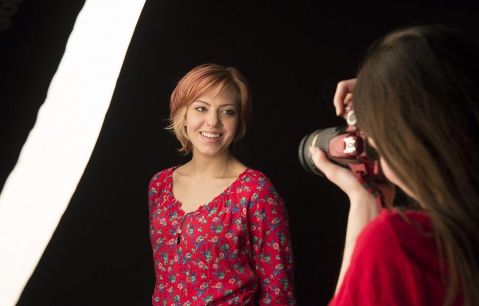 Student in lighting studio