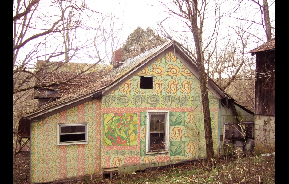 a pastel-colored quilt pattern pasted on a house