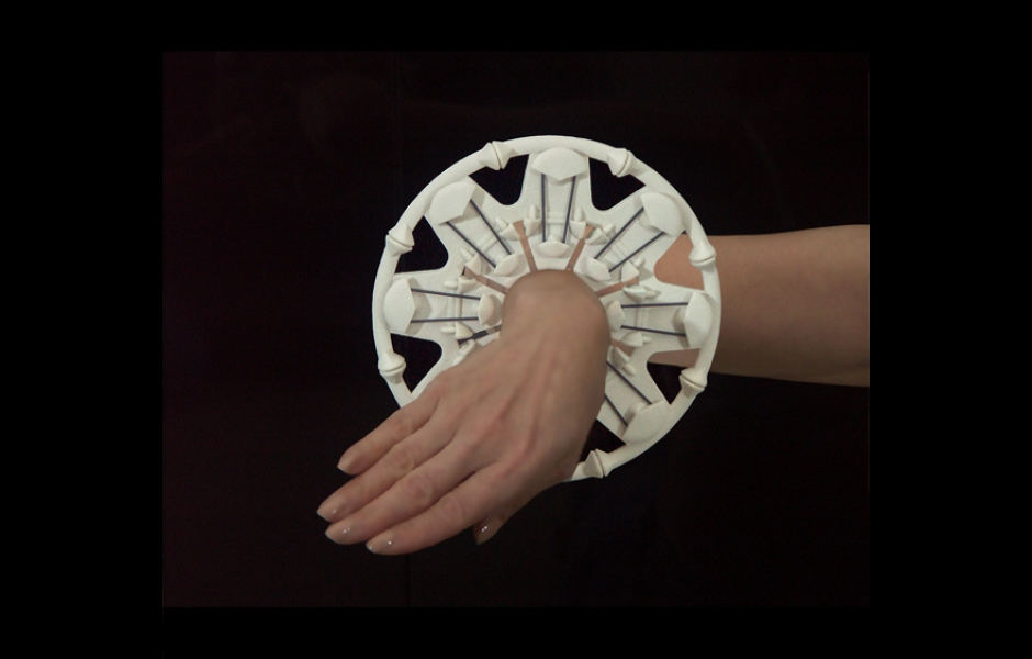 hand with large white circular bracelet