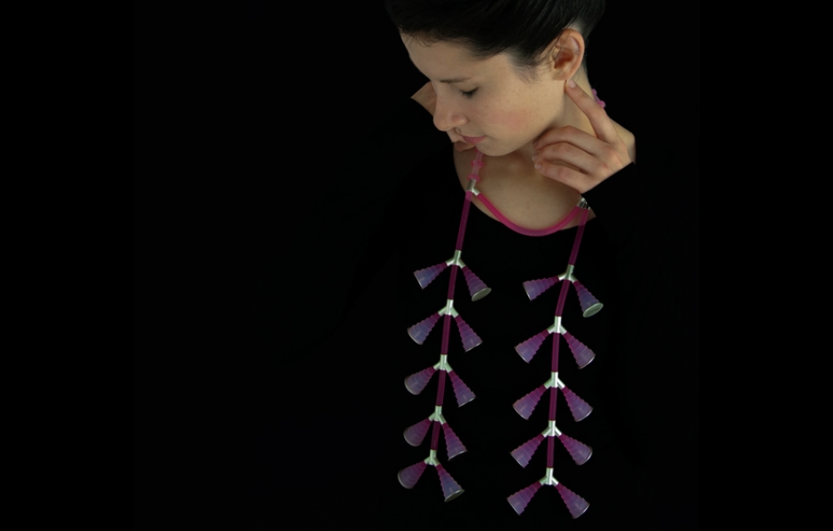 model where long pink and purple neckpiece